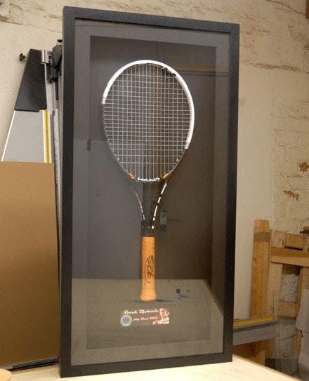 Framed tennis racket
