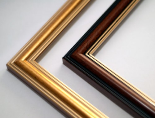 Compare the gold and brown frames